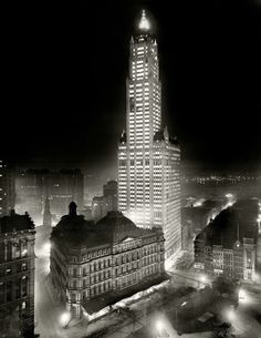 1913..The Woolworth Building at night, New York.