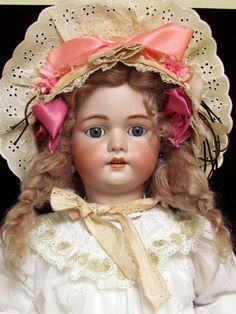 Hey, I found this really awesome Etsy listing at http://www.etsy.com/listing/158312997/29-lovely-antique-german-bisque-head. Simon & Halbig.