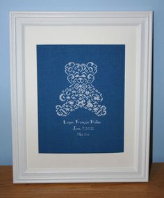 JBW's Teddy Bear stitched as a boy's baby sampler and framed.