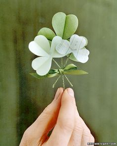 shamrock boutonnieres--wish I was going to a st. paddy's day wedding this year!