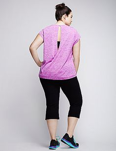 As ready to move as it is ready to show off: This LIVI Active tee reveals a flash of skin through the draped open back. Seaming at sides for a flattering fit. lanebryant.com