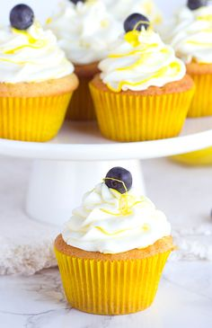 BOOZY Blueberry Lemon Cupcakes. Homemade blueberry filling, lemon cupcakes with a punch of limoncello, and limoncello frosting all in the perfect little package. http://thecupcakedailyblog.com/boozy-blueberry-lemon-cupcakes/ #boozycupcakerecipe