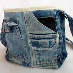 Upcycled Denim Pockets Crossover Bag. $37.00, Etsy.  Inspiration: remove zipper, rmove waist band, add lining and bring edge over the top.