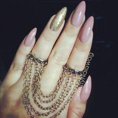 Stiletto nails. (Minus that chain thing)