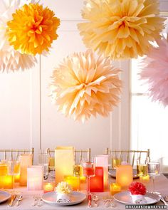 Tissue paper poms for a fall baby shower. Do them up in purple, pink and orange like hanging chrysanthemums.