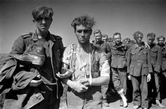 German Wehrmacht soldiers are captured by the Soviets during the Belgorod-Khar'kov Offensive Operation, also known as the Fourth Battle of Kharkov (Kharkiv). After losing the city and surrounding area to the Germans in the First Battle of Kharkov in October 1941, it would take the Soviets three more bloody battles to finally liberate the area from Axis occupation. Near Kharkov (Kharkiv), Kharkiv Oblast, Ukraine, U.S.S.R. August 1943. Image taken by Simon Friedland.