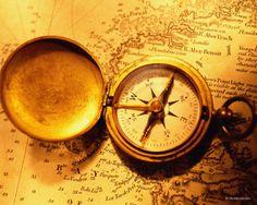 """Compass tattoo with """"nostos ou topos o lungo drom"""" around it"""