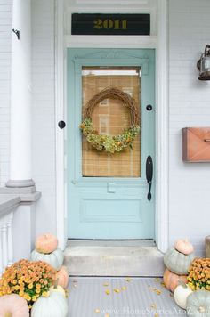 Farmhouse style fall porch decorating idea.