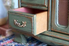 Thrift store jewelry cabinet makeover, close up of drawer | DuctTapeAndDenim.com #thriftstorefind #thriftstoremakeover #paintedcabinet #jewelrycabinet #greenjewelrycabinet #chalkyfinishpaint #jewelrycabinetmakeover #cabinetmakeover #DIYjewelrycabinet