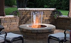 2 of my favorites... a water feature to listen to as I sit by the fire pit!  Best of both worlds!!!