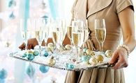 Mix ornaments with glasses on tray