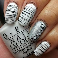 Cool summer nails :) got to remember to try this minus the ring finger design.