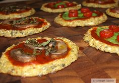 These are small pizzas perfect for a group of people or a picky family.  You have more opportunity with smaller pizzas to give variety to the toppings...everyone is happy!  Crust: 4 cups riced cauliflower (see below) 2 eggs 1.5 teaspoons sea salt 1/4 cup almond meal 2 tablespoons fresh oregano, chopped Toppings: Go wild!  This is where your preferences come into play.  Start with your favorite marinara sauce as a base for each pizza. I made three different pizzettes:  mushroom…