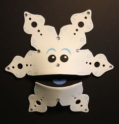 Snowflake puppet - Playsoup. Love the fun foam snowflake patterns.