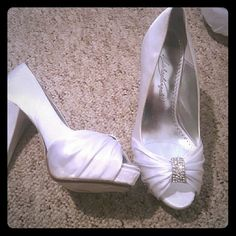Wedding shoes Brand new with price and the box.. got them in 2012 never used them. Diana white Shoes Heels