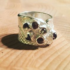 Extra wide garnet and fine silver wrap ring #designersilverjewelry #handmadesilverjewelry #designerjewelry #silverring #photooftheday #fashion #fashionjewelry #designersilverjewelry