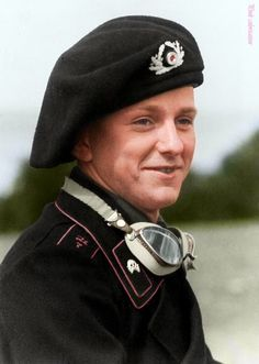 A young enlisted panzer crewman wearing a Schutzmütze (Black Panzer Beret). The 30 October 1935, a standard had been established for the wearing of insignia on the black panzer beret but the 15 January 1941, the black panzer beret was abolished and replaced, however, it was maintained for crews of the Panzer type 38(t), of Czech manufacture, for drivers and co-drivers of armored personnel carriers.