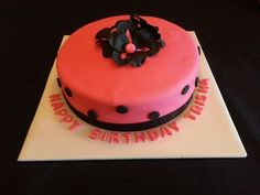 Hot pink polka dot chocolate layer cake by A Cupcake Queen - Crystal Gruber.