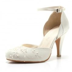 3.5 inches heel with satin scallop trimmings at the side. These closed toe wedding shoes come with adjustable ankle straps and inctricate bead work details at the toe box. Made from french lace, silk ...