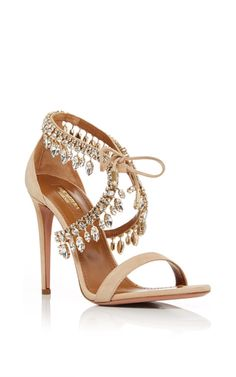 The brainchild of Colombian-born footwear designer, Edgardo Osorio, Aquazzura combines the best of craftsmanship and glamorous allure—masterfully produced in Italy of the finest nappa leather for a perfect fit every time. These **Aquazurra** heels stand out with beaded jewels and a suede tie front—the height of evening sophistication.