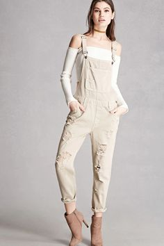 Forever 21+ - A pair of denim overall by Caffeine™ featuring an allover distressed design, adjustable straps, a large bib pocket with a small pocket accent, five-pocket construction, belt loops, a side button and zipper closure, and a mock fly front.