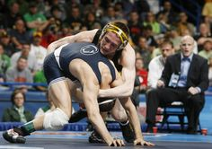 17 MAR 2012: Matt McDonough of the University of Iowa, right, wrestles Nicholas Megaludis of Penn State during the Division I Men's Wrestling Championship held at Scottrade Center in St. Louis, MO. McDonough defeated Megaludis 4-1 to win the 125 lb national title. Tom Gannam/NCAA Photos