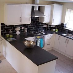 after a 7 year wait new kitchen installed cream gloss slab with