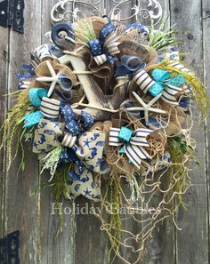 A personal favorite from my Etsy shop https://www.etsy.com/listing/289460445/nautical-wreath-beach-wreath-anchor
