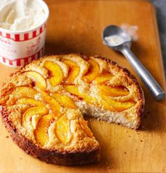 German settlers brought the recipe for this tender coffee cake to the northern plains. The industrious pioneers changed up the taste by folding local fruits into the batter: apple, gooseberry, plum and even no-fruit cottage cheese. Here's our biscuitlike version with summery peaches. Serve it warm for breakfast or with ice cream for dessert.