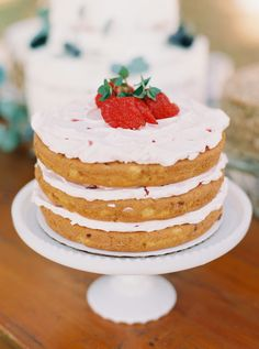 Strawberry naked cake with strawberry topping: http://www.stylemepretty.com/2016/07/13/st-simons-teal-colored-wedding/ | Photography: Kylie Martin Photography - http://www.kyliemartinphotography.com/