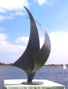 This sculpture represents a sail:Two Sail Sculpture. The piece was designed by Paul Margetts.