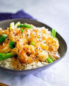 If you love tasty, quick and easy dinners then this Takeout Style Ginger Shrimp Stir Fry recipe takes less than 10 minutes to make and tastes amazing! A simple sauce made with easy to find grocery store ingredients - honey, garlic, soy sauce, sesame oil, green onions/scallions and plenty of ginger. Serve it with fried rice for a takeout style treat, or go healthy with veggies and steamed brown rice. Or add noodles for a different ginger shrimp dinner! #easyshrimprecipe #shrimpstirfry Rice Noodle Recipes, White Rice Recipes, Stir Fry Recipes, Shrimp Recipes Easy, Fish Recipes, Seafood Recipes, Asian Recipes, Shrimp Stir Fry, Shrimp And Rice