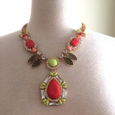 Pink & Yellow necklace Gorgeous necklace! It has a gold chain. There are pink and neon yellow gems featured in the center. Worn a couple times. Jewelry Necklaces