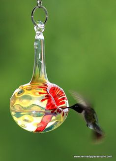 Hummingbird Feeder, The Kennedy Style Hummingbird Feeder, The Original One Piece Drip-less Hummingbird Feeder/Silver Hobnail. $50.00, via Etsy.