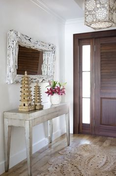 The rug, the mirror, the side board.