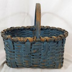 Century A great early century blue over an old surface. on Apr 2018 Old Baskets, Vintage Baskets, Painted Baskets, Country Treasures, Art Deco Diamond, Diamond Brooch, Wooden Basket, Raffle Baskets, Antique Paint