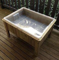 DIY sensory table. Aldi raised garden bed with IKEA tub.