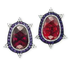 A PAIR OF GARNET, TOURMALINE, AMETHYST AND DIAMOND EAR CLIPS, BY JAR Centering upon a pear-shaped garnet, weighing approximately 24.53 carats, and a pear-shaped tourmaline, weighing approximately 28.95 carats, to the amethyst and diamond surround enhanced by diamond trefoil accents, 1995, 4.1 cm, with French assay marks for silver and gold Signed JAR Paris