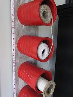 Vertical coffee can storage for string & twine, complete with a ruler on the side to measure out the perfect length