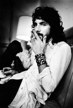 Cat Stevens, always thought he was great looking ,; of course without the smoke