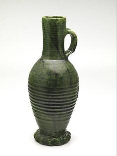 jug 1375 - 1425 Dimensions h. 33 x diam. 13 cm Material and technique stoneware, lead glaze, copper oxide