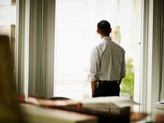 Foto de stock : Businessman looking out office window
