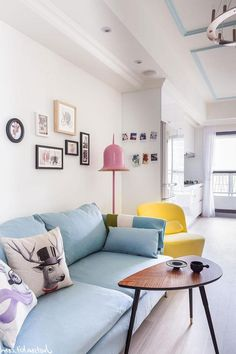 http://www.gopret.com/wp-content/uploads/2015/01/amusing-living-room-pop-art-style-design-with-blue-fabric-sofa-and-unique-shaped-wooden-table-on-hardwood-floor-along-with-yellow-chair-beside-pink-lamps-standing-corner-as-well-frame-on-the-wall.jpg
