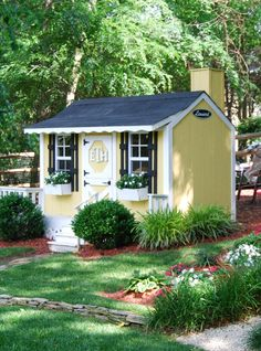 adorable yellow playhouse that looks like a real house