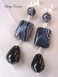 I made these earrings with striped agate, black agate( onyx) and sterling silver. All the metallic parts are made of sterling silver. Chic and unique!! Their measures are: 6,5 cm, including earstud. Weight: 11,2 gr Organza bag as a gift! I send them with registrered post. If you have