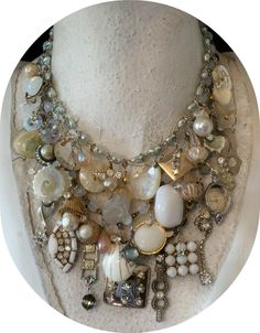 Have old broaches laying around? Fasten them to a multi-strand necklace for a dramatic statement piece.