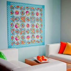 Colorful sashing unlocks a subtle pattern of stars in blocks pieced from low-contrast fabrics.