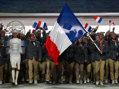Nordic combined skier Jason Lamy-Chappuis of the France Olympic team carries his country's flag during the Opening Ceremony of the Sochi 2014 Winter Olympics at Fisht Olympic Stadium. Sochi 2014 Opening Ceremony - Teams