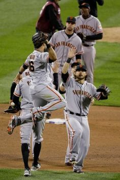 Giants' Angel Pagan (16) Celebrates with Teammates after NLCS Game 5.