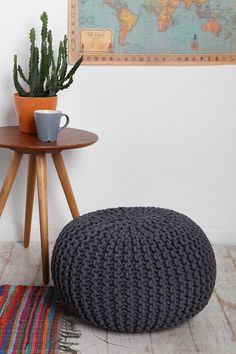 Cactus, rug, Cable Knit Pouf, and map.  #urbanoutfitters